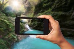 Fucilazione della foto sullo smartphone Immagine Stock