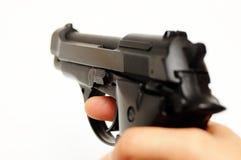 Fucilazione della pistola Immagini Stock