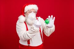 Free Fuck You Covid. Photo Of Old Bearded Santa Hold Flu Bacteria Holly Atmosphere Save Winter Holidays Show Middle Finger Royalty Free Stock Photo - 185538545