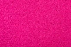 Close up on pink felt texture as a background. stock photo