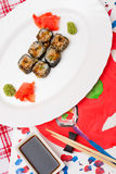 Fud art. Japanese sushi on a white plate Royalty Free Stock Photos