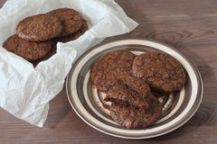 Fudge brownie cookies on crockery plate. And dark background royalty free stock images