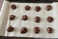 Fudge brownie cookies raw on parchment Royalty Free Stock Image