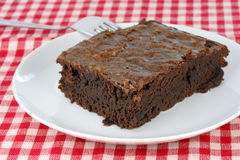Fudge brownie on white plate Royalty Free Stock Photos