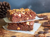 Fudge brownies dark chocolate cake topping with almond slice. Stock Photo