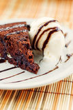 Fudge cake with vanilla ice cream Stock Photography