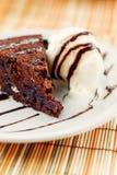 Fudge cake with vanilla ice cream Stock Photography
