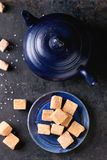 Fudge cand and teapot Stock Images