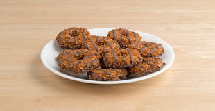Fudge coconut caramel cookies on a white plate Royalty Free Stock Photo