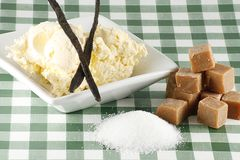 Fudge cream and sugar. Fudge candy clotted cream and sugar on a gingham cloth Stock Images