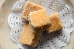 Fudge Cubes Arranged on Doily Overhead Close Up Stock Photo