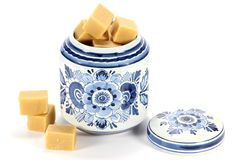 Fudge. In delftware container isolated on white background Royalty Free Stock Photo