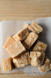 Fudge Pieces From Above on Parchment and Wood Royalty Free Stock Photography