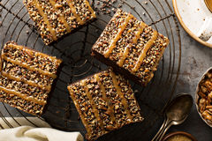Fudgy brownies with nuts and caramel Stock Images