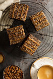 Fudgy brownies with nuts and caramel Stock Image