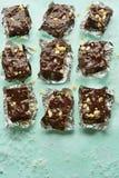 Fudgy chocolate nut squares. On blue background Stock Image