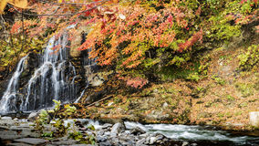 Fudo stream and the red bridge at Mount Nakano-Momiji Stock Image