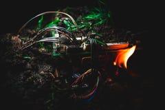 Fuego cogido placa madre Foto de archivo libre de regalías