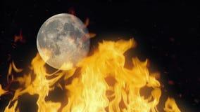 Fuego con la luna en fondo almacen de video