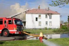 Fuego de la casa Foto de archivo libre de regalías