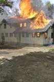 Fuego de la casa Fotografía de archivo libre de regalías