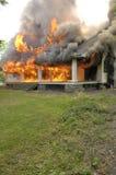 Fuego de la casa Imágenes de archivo libres de regalías