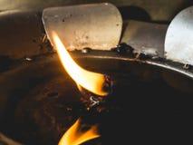 Fuego de la lámpara de aceite en templo Fotografía de archivo libre de regalías