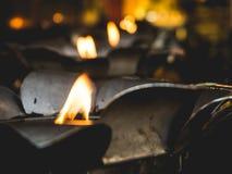 Fuego de la lámpara de aceite en templo Imágenes de archivo libres de regalías