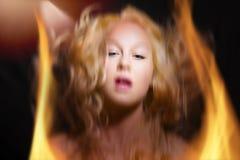 Fuego de la mujer del pánico Imagen de archivo libre de regalías