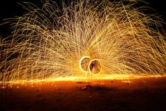 Fuego de la vuelta de la gente Fotografía de archivo