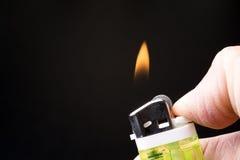 Fuego del encendedor Foto de archivo