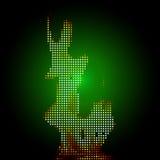 Fuego del pixel en un fondo verde Foto de archivo libre de regalías
