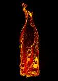 Fuego en la dimensión de una variable de una botella Foto de archivo libre de regalías