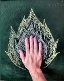 Fuego en mi dibujo de la pizarra de la mano Foto de archivo