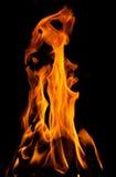 Fuego en un fondo negro Imagenes de archivo