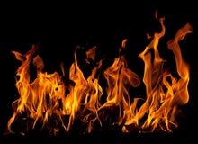 Fuego en un fondo negro Foto de archivo libre de regalías
