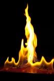 Fuego en un fondo oscuro Imagen de archivo libre de regalías