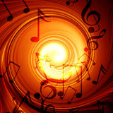 Fuego que remolina con las notas de la música Fotografía de archivo