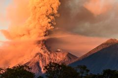 Fuego volcano erupting at dawn, Antigua, Guatemala. Fuego volcano erupting at dawn next to Acatenango volcano near Antigua, Guatemala, Central America royalty free stock photography