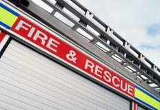 Fuego y carro del rescate fotografía de archivo