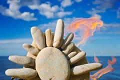 Fuego y el sol de piedra Imagen de archivo libre de regalías
