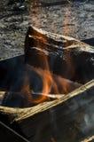 Fuego y humo en un brasero Imagen de archivo libre de regalías