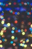 Fuegos artificiales abstractos amarillos azules de las luces de la Navidad Foto de archivo libre de regalías