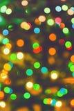 Fuegos artificiales abstractos amarillos verdes de las luces de la Navidad Imagen de archivo libre de regalías