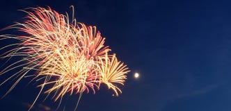 Fuegos artificiales con la luna Imágenes de archivo libres de regalías