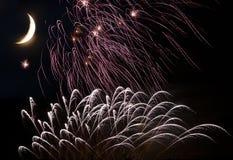 Fuegos artificiales con la luna en el cielo Fotografía de archivo libre de regalías