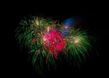 Fuegos artificiales en la noche Fotos de archivo libres de regalías
