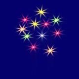 Fuegos artificiales festivos, multicolores en un ejemplo azul del fondo Imagenes de archivo