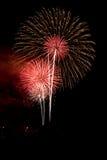 Fuegos artificiales rojizos de la celebración Imágenes de archivo libres de regalías
