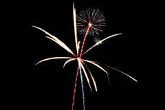 Fuegos artificiales rojos, blancos y azules Imágenes de archivo libres de regalías